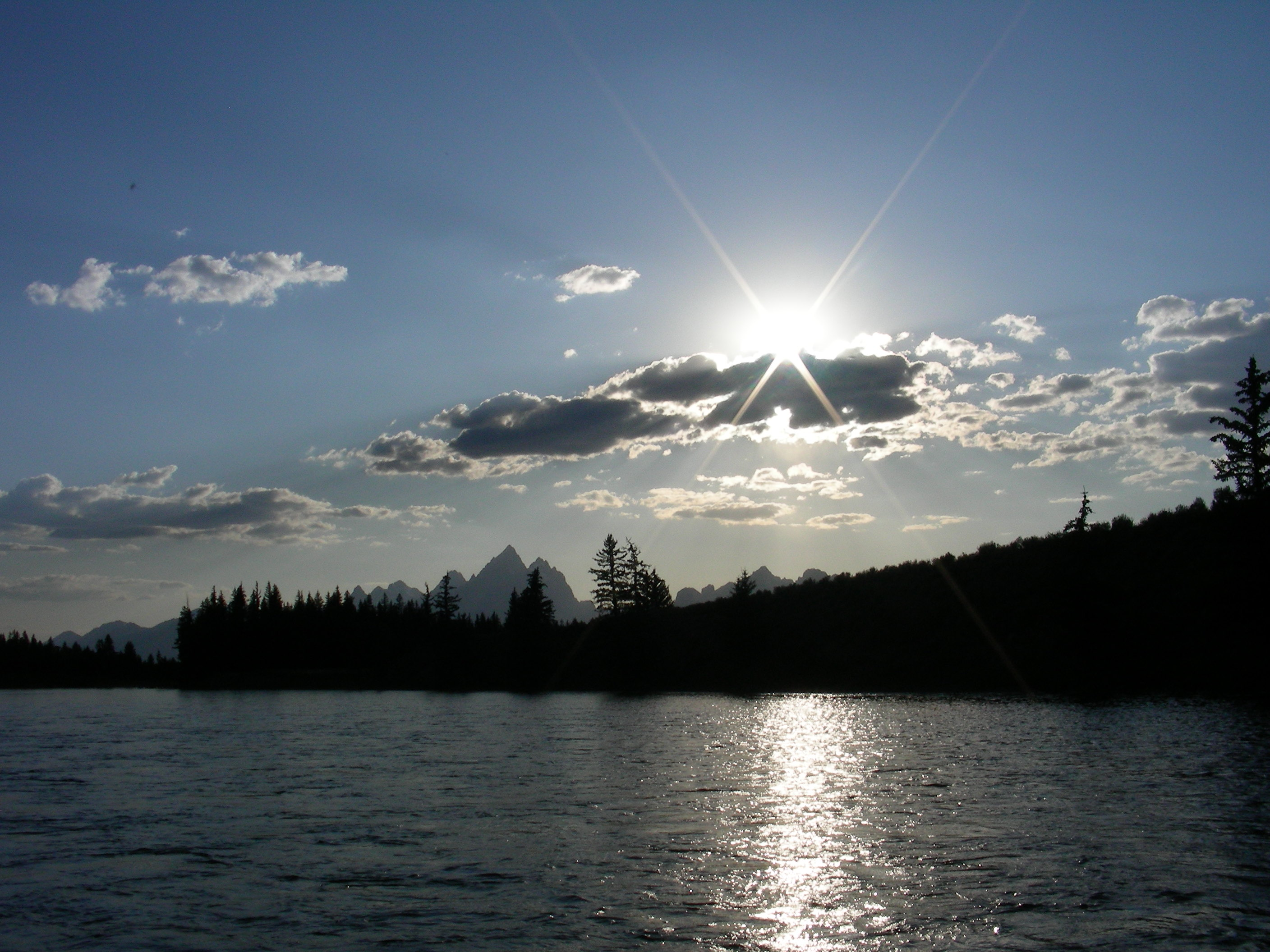 grand teton sun on river
